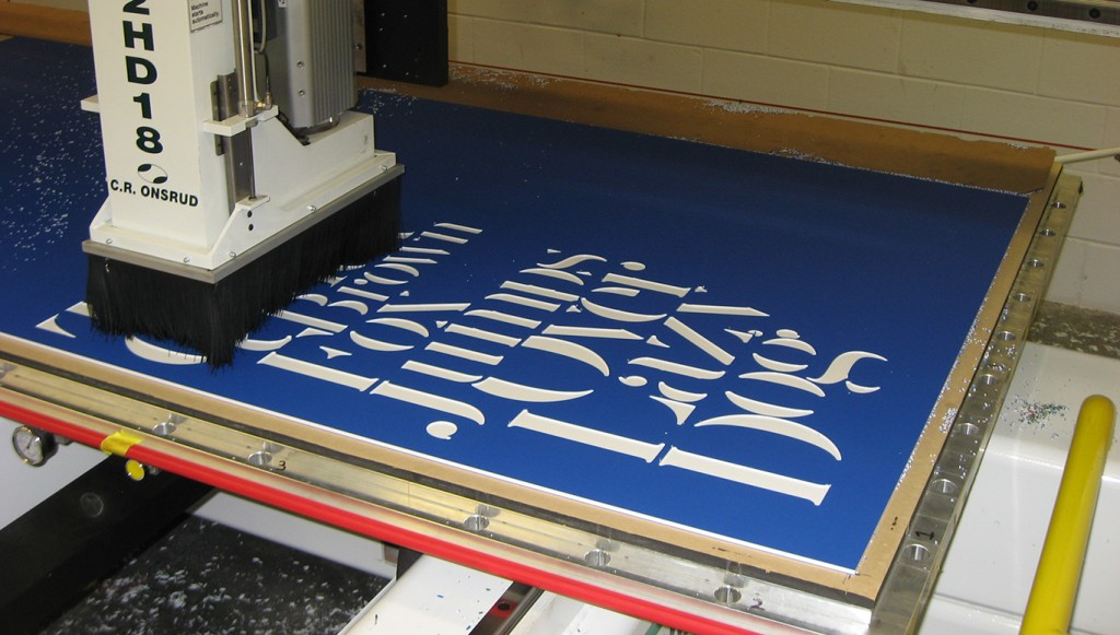 cnc router making a sign with king colorcore bluewhiteblue - Color Core Laminate